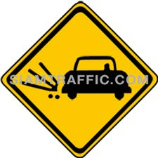 Warning Sign ผิวทางร่วน ทางข้างหน้ามีวัสดุผิวทางหลุดกระเด็นเมื่อขับรถด้วยความเร็วสูง ให้ขับรถให้ช้าลง และระมัดระวังอันตรายอันอาจเกิดจากวัสดุผิวทาง